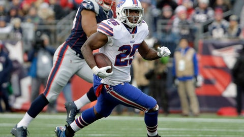 FILE - In this Dec. 24, 2017, file photo, Buffalo Bills running back LeSean McCoy (25) runs from New England Patriots defensive end Trey Flowers, rear, during the second half of an NFL football game in Foxborough, Mass. The Bills have not been to the playoffs since the 1999 season, the longest active drought in North America's four major professional sports. (AP Photo/Steven Senne, File)