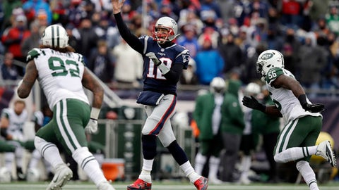 New England Patriots quarterback Tom Brady (12) passes under pressure from New York Jets defensive end Leonard Williams (92) and linebacker Demario Davis (56) during the first half of an NFL football game, Sunday, Dec. 31, 2017, in Foxborough, Mass. (AP Photo/Charles Krupa)
