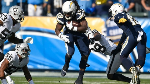 Los Angeles Chargers running back Melvin Gordon runs up the middle during the first half of an NFL football game against the Oakland Raiders, Sunday, Dec. 31, 2017, in Carson, Calif. (AP Photo/Kelvin Kuo)