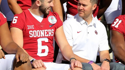 Oklahoma quarterback Baker Mayfield talks with coach Lincoln Riley during the official team photo at the Rose Bowl on Sunday, Dec. 31, 2017, in Pasadena, Calif. Georgia plays Oklahoma on Monday in a College Football Playoff semifinal. (Curtis Compton/Atlanta Journal-Constitution via AP)