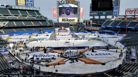A hockey rink is set up on the infield at Citi Field in New York on Sunday, Dec. 31, 2017. The Buffalo Sabres play the New York Rangers on Monday in the NHL's New Year's Day game. Both teams practiced on the ice with the temperature around 16 degrees, the same as is forecast for the start of the game on Monday. (AP Photo/Vin A. Cherwoo)