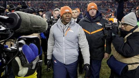 Denver Broncos coach Vance Joseph walks off the field after the team's 27-24 loss to the Kansas City Chiefs during an NFL football game Sunday, Dec. 31, 2017, in Denver. (AP Photo/Joe Mahoney )