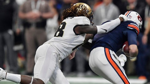 Auburn defensive back Jayvaughn Myers (18) sacks Auburn quarterback Jarrett Stidham (8) during the first half of the Peach Bowl NCAA college football game, Monday, Jan. 1, 2018, in Atlanta. (AP Photo/Mike Stewart)