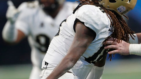 Central Florida linebacker Shaquem Griffin (18) celebrates a sack on Auburn quarterback Jarrett Stidham (8) during the second half of the Peach Bowl NCAA college football game, Monday, Jan. 1, 2018, in Atlanta. (AP Photo/John Bazemore)