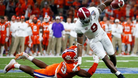 Alabama running back Bo Scarbrough (9) carries against Clemson defensive end Clelin Ferrell (99) in the first half of the Sugar Bowl semi-final playoff game for the NCAA college football national championship, in New Orleans, Monday, Jan. 1, 2018. (AP Photo/Butch Dill)