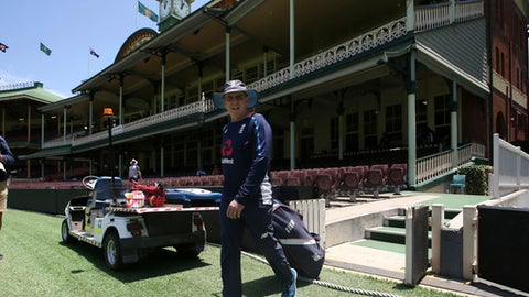England's head coach Trevor Bayliss drags a bag of equipment on the the Sydney Cricket Ground during training for their Ashes cricket test match against Australia in Sydney, Tuesday, Jan. 2, 2018. The test begins on Thursday. (AP Photo/Rick Rycroft)