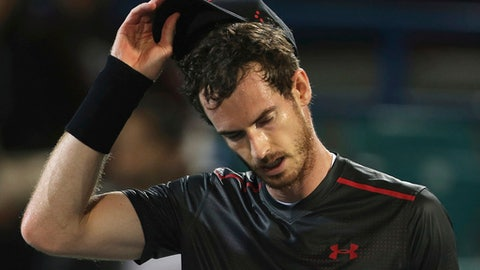 FILE - In this Friday, Dec. 29, 2017, file photo, Great Britain's Andy Murray reacts after he lost a match to Spain's Roberto Bautista Agut during the second day of the Mubadala World Tennis Championship in Abu Dhabi, United Arab Emirates. Murray has withdrawn from the Brisbane International because of a problem with his right hip. The former No. 1-ranked Murray had been scheduled to play his first match on Thursday, but notified organizers he was pulling out after failing to practice on Tuesday. (AP Photo/Kamran Jebreili, File)
