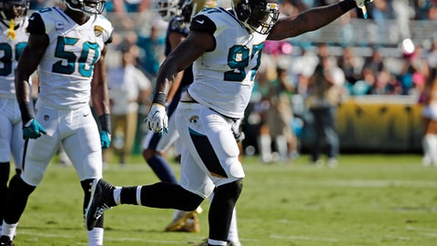 FILE - In this Oct. 15, 2017, file photo, Jacksonville Jaguars defensive lineman Malik Jackson (97) celebrates a big play with linebacker Telvin Smith (50) during the first half of an NFL football game against the Los Angeles Rams, in Jacksonville, Fla. The Jaguars (10-6) are short on postseason experience heading into Sunday's AFC wild-card game against Buffalo, with 11 guys having played a combined 42 playoff games. Jackson (eight) and fellow defensive lineman Calais Campbell (nine) have accounted for nearly half of those games in January and February. (AP Photo/Stephen B. Morton, File)