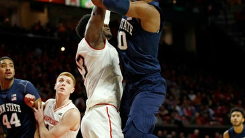 Penn State guard Tony Carr, right, shoots over Maryland forward Bruno Fernando, of Angola, in the first half of an NCAA college basketball game in College Park, Md., Tuesday, Jan. 2, 2018. (AP Photo/Patrick Semansky)