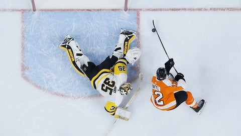 Philadelphia Flyers' Michael Raffl, right, cannot get a shot past Pittsburgh Penguins' Tristan Jarry during the second period of an NHL hockey game, Tuesday, Jan. 2, 2018, in Philadelphia. (AP Photo/Matt Slocum)
