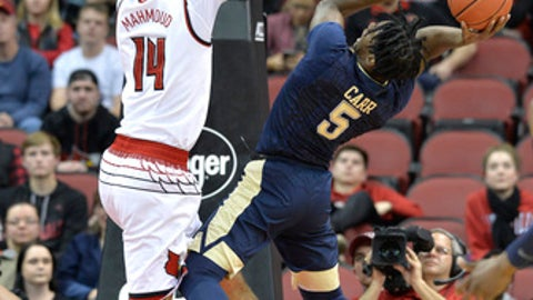 Louisville forward Anas Mahmoud (14) attempts to block the shot of Pittsburgh guard Marcus Carr (5) during the second half of an NCAA college basketball game, Tuesday, Jan. 2, 2018, in Louisville, Ky. Louisville won 77-51. (AP Photo/Timothy D. Easley)