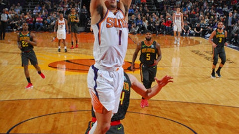 PHOENIX, AZ - JANUARY 2: Devin Booker #1 of the Phoenix Suns dunks the ball against the Atlanta Hawks on January 2, 2018 at Talking Stick Resort Arena in Phoenix, Arizona. NOTE TO USER: User expressly acknowledges and agrees that, by downloading and or using this photograph, user is consenting to the terms and conditions of the Getty Images License Agreement. Mandatory Copyright Notice: Copyright 2018 NBAE (Photo by Barry Gossage/NBAE via Getty Images)
