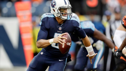 FILE - In this Nov. 12, 2017, file photo, Tennessee Titans quarterback Marcus Mariota (8) plays against the Cincinnati Bengals in the second half of an NFL football game, in Nashville, Tenn. The Titans take on the Kansas City Chiefs in a wild-card playoff game on Saturday, Jan. 6, 2018 in Kansas City. (AP Photo/James Kenney, File)