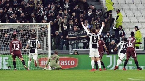 Juventus' Douglas Costa, second from right, celebrates after scoring during an Italian Cup quarter-final soccer match between Juventus and Torino at the Allianz Stadium in Turin, Italy, Wednesday, Jan. 3, 2018. (Andrea Di Marco/ANSA via AP)