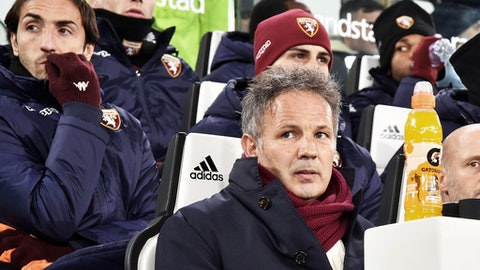 Torino's coach Sinisa Mihajlovic sits on the bench ahead of an Italian Cup quarter-final soccer match between Juventus and Torino at the Allianz Stadium in Turin, Italy, Wednesday, Jan. 3, 2018. (Andrea Di Marco/ANSA via AP)