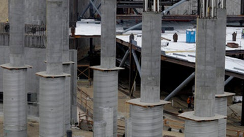 Construction personnel work at the site of the new Inglewood NFL stadium on Wednesday, Jan. 3, 2018, in Inglewood, Calif. The new facility for the Los Angeles Rams, Los Angeles Chargers is tentatively scheduled to be competed for the 2020 NFL football season. (AP Photo/Chris Carlson)