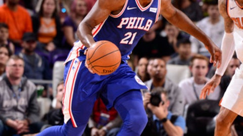 PHOENIX, AZ - DECEMBER 31: Joel Embiid #21 of the Philadelphia 76ers handles the ball against the Phoenix Suns on December 31, 2017 at Talking Stick Resort Arena in Phoenix, Arizona. NOTE TO USER: User expressly acknowledges and agrees that, by downloading and or using this photograph, user is consenting to the terms and conditions of the Getty Images License Agreement. Mandatory Copyright Notice: Copyright 2017 NBAE (Photo by Barry Gossage/NBAE via Getty Images)