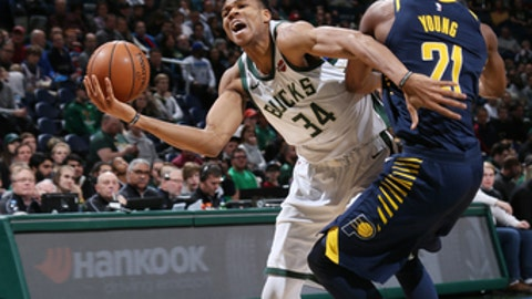 MILWAUKEE, WI - JANUARY 3:  Giannis Antetokounmpo #34 of the Milwaukee Bucks handles the ball against the Indiana Pacers on January 3, 2018 at the BMO Harris Bradley Center in Milwaukee, Wisconsin. NOTE TO USER: User expressly acknowledges and agrees that, by downloading and or using this Photograph, user is consenting to the terms and conditions of the Getty Images License Agreement. Mandatory Copyright Notice: Copyright 2018 NBAE (Photo by Gary Dineen/NBAE via Getty Images)