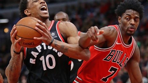CHICAGO, IL - JANUARY 03:  DeMar DeRozan #10 of the Toronto Raptors drives against Justin Holiday #7 of the Chicago Bulls at the United Center on January 3, 2018 in Chicago, Illinois. NOTE TO USER: User expressly acknowledges and agrees that, by downloading and or using this photograph, User is consenting to the terms and conditions of the Getty Images License Agreement.  (Photo by Jonathan Daniel/Getty Images)
