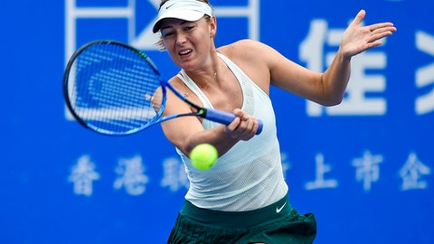 In this photo provided by China's Xinhua News Agency,  Maria Sharapova of Russia returns the ball during a quarter final match against Zarina Diyas of Kazakhstan at the WTA Shenzhen Open tennis tournament in Shenzhen, south China's Guangdong Province, Thursday, Jan. 4, 2018. (Mao Siqian/Xinhua News Agency via AP)