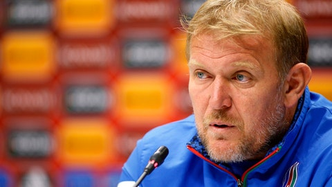 FILE - In this Friday, Oct. 9, 2015 file photo, Azerbaijan's head coach Robert Prosinecki speaks to the media during a press conference at the Olympic stadium in Baku, Azerbaijan. Former Croatia and Real Madrid midfielder Robert Prosinecki has been hired to coach the Bosnia and Herzegovina national team, it was announced Thursday, Jan. 4, 2018. Prosinecki spent the past three years coaching Azerbaijan's national team. (AP Photo/Mindaugas Kulbis, file)