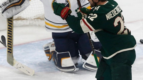 Minnesota Wild's Nino Niederreiter, right, of Switzerland, celebrates one of his two goals in the first period of an NHL hockey game off Buffalo Sabres goalie Robin Lehner of Sweden, Thursday, Jan. 4, 2018, in St. Paul, Minn. (AP Photo/Jim Mone)