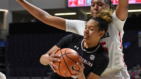 South Carolina forward Alexis Jennings (35) looks for room past Mississippi forward Promise Taylor (55) during the second half of an NCAA college basketball game in Oxford, Miss., Thursday, Jan. 4, 2018. South Carolina won 88-62. (AP Photo/Thomas Graning)