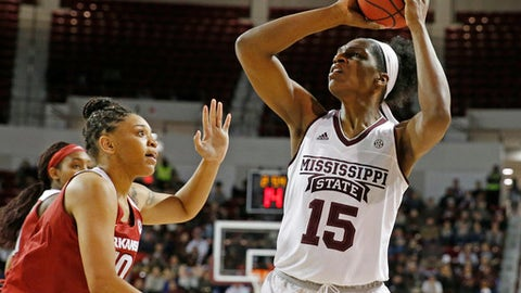 Mississippi State center Teaira McCowan (15) looks for a shot as Arkansas forward Kiara Williams (10) defends during the first half of an NCAA college basketball game in Starkville, Miss., Thursday, Jan. 4, 2018. (AP Photo/Rogelio V. Solis)