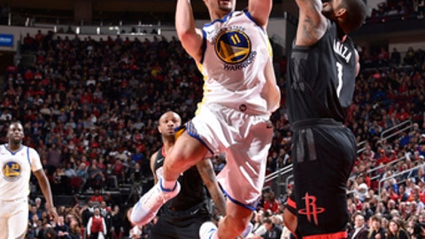 HOUSTON, TX - JANUARY 4: Klay Thompson #11 of the Golden State Warriors goes to the basket against the Houston Rockets on January 4, 2018 at the Toyota Center in Houston, Texas. NOTE TO USER: User expressly acknowledges and agrees that, by downloading and/or using this photograph, user is consenting to the terms and conditions of the Getty Images License Agreement. Mandatory Copyright Notice: Copyright 2018 NBAE (Photo by Bill Baptist/NBAE via Getty Images)