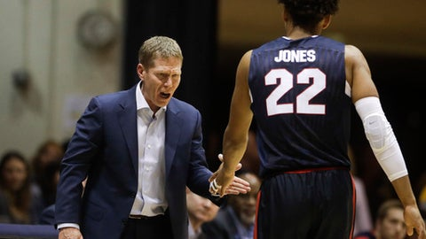 Gonzaga's Jeremy Jones is greeted by head coach Mark Few during the first half of an NCAA college basketball game against Pepperdine, Thursday, Jan. 4, 2018, in Malibu, Calif. (AP Photo/Jae C. Hong)