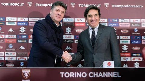 President of Torino Urbano Cairo, right, shakes hands with newly hired coach of Torino Walter Mazzarri during his presentation at the Olympic stadium in Turin, Italy, Friday, Jan.  5, 2018. Mazzarri replaces fired coach Sinisa Mihajlovic. (Alessandro Di Marco/ANSA via AP)