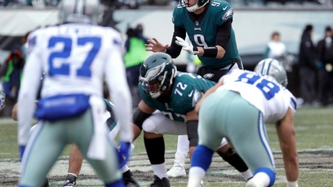 FILE - In this Dec. 31, 2017, file photo, Philadelphia Eagles quarterback Nick Foles waits for the snap during the first half of the team's NFL football game against the Dallas Cowboys in Philadelphia. The Eagles are the NFC's No. 1 seed but no longer are Super Bowl favorites after losing MVP candidate Carson Wentz in Week 14. Oddsmakers have three NFC teams listed ahead of Philadelphia.  Backup Foles played well the first five quarters he filled in for Wentz but struggled in the last five. (AP Photo/Michael Perez, File)