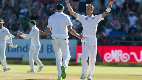 South African bowler Dale Steyn celebrates the wicket of Indian batsman Shikhar Dhawan on the first day of the first test between South Africa and India at Newlands Stadium in Cape Town South Africa Friday Jan. 5 2018