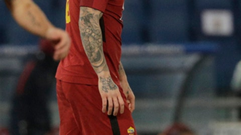 """FILE - In this Saturday, Dec. 16, 2017 file photo, Roma's Radia Nainggolan looks down during a Serie A soccer match between Roma and Cagliari, at the Olympic stadium in Rome. A series of drunken Instagram postings on New Year's Eve has resulted in midfielder Radja Nainggolan being fined and dropped from Roma's squad for Saturday's match against Atalanta. Coach Eusebio Di Francesco says that """"whoever represents Roma must do so continually, certain errors are no longer acceptable."""" Di Francesco adds, """"Nainggolan knows what he did. After all, he made the video by himself, and he has assumed responsibility."""" (AP Photo/Gregorio Borgia, File)"""