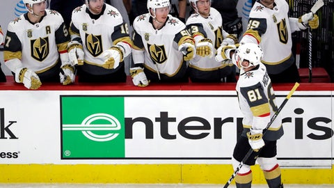 Vegas Golden Knights center Jonathan Marchessault (81) celebrates with teammates after scoring a goal against the Chicago Blackhawks during the first period of an NHL hockey game Friday, Jan. 5, 2018, in Chicago. (AP Photo/Nam Y. Huh)