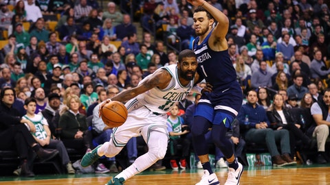 BOSTON, MA - JANUARY 4: Kyrie Irving #11 of the Boston Celtics drives against Tyus Jones #1 of the Minnesota Timberwolves during the second half at TD Garden on January 5, 2018 in Boston, Massachusetts. The Celtics defeat the Timberwolves 91-84. (Photo by Maddie Meyer/Getty Images)
