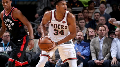 MILWUAKEE, WI - JANUARY 5:  Giannis Antetokounmpo #34 of the Milwaukee Bucks handles the ball against the Toronto Raptors on January 5, 2018 at the BMO Harris Bradley Center in Milwaukee, Wisconsin. NOTE TO USER: User expressly acknowledges and agrees that, by downloading and or using this Photograph, user is consenting to the terms and conditions of the Getty Images License Agreement. Mandatory Copyright Notice: Copyright 2018 NBAE (Photo by Gary Dineen/NBAE via Getty Images)