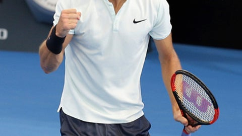 Grigor Dimitrov of Bulgaria reacts after winning the first set in his semi final match against Nick Kyrgios of Australia during the Brisbane International tennis tournament in Brisbane, Australia, Saturday, Jan. 6, 2018. (AP Photo/Tertius Pickard)
