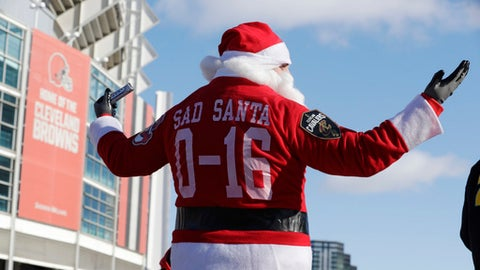 "A Cleveland Browns fan dressed as Santa Claus participates in the ""Perfect Season"" parade, Saturday, Jan. 6, 2018, in Cleveland. The Browns became the second team in NFL history to lose 16 games in a season. In joining the 2008 Detroit Lions in a shameful loser's club, the Browns have found a new low in what has been nearly two decades of disgrace since returning as an expansion franchise in 1999. (AP Photo/Tony Dejak)"