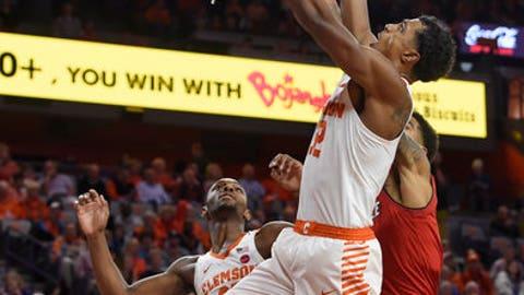 No. 25 Clemson holds off Louisville in OT