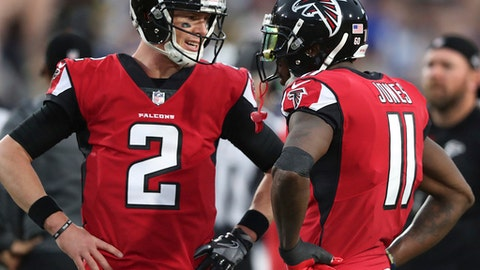 Atlanta Falcons' Matt Ryan, left, and Julio Jones confer as they prepare to play the Los Angeles Rams in an NFL football wild-card playoff game Saturday, Jan. 6, 2018, in Los Angeles. (Curtis Compton/Atlanta Journal-Constitution via AP)