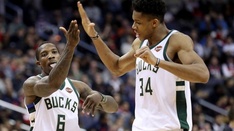WASHINGTON, DC - JANUARY 6: Eric Bledsoe #6 celebrates with Giannis Antetokounmpo #34 of the Milwaukee Bucks after hitting a three pointer in the fourth quarter against the Washington Wizards during the Bucks 110-103 win at Capital One Arena on January 6, 2018 in Washington, DC. NOTE TO USER: User expressly acknowledges and agrees that, by downloading and or using this photograph, User is consenting to the terms and conditions of the Getty Images License Agreement. (Photo by Rob Carr/Getty Images)