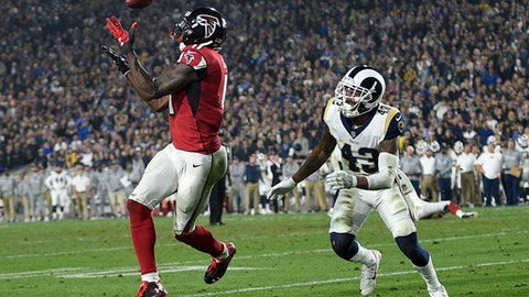 Atlanta Falcons wide receiver Julio Jones, left, catches a touchdown pass ahead of Los Angeles Rams strong safety John Johnson during the second half of an NFL football wild-card playoff game Saturday, Jan. 6, 2018, in Los Angeles. (AP Photo/Kelvin Kuo)