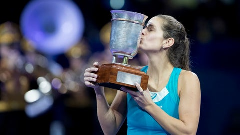 Winner Julia Goerges of Germany kisses the trophy after the final match at the Kremlin Cup tennis tournament in Moscow, Russia, Saturday, Oct. 21, 2017.  (AP Photo/Pavel Golovkin)