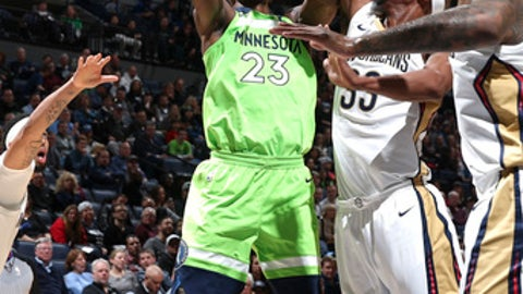 MINNEAPOLIS, MN -  JANUARY 6: Jimmy Butler #23 of the Minnesota Timberwolves shoots the ball against the New Orleans Pelicans on January 6, 2018 at Target Center in Minneapolis, Minnesota. NOTE TO USER: User expressly acknowledges and agrees that, by downloading and or using this Photograph, user is consenting to the terms and conditions of the Getty Images License Agreement. Mandatory Copyright Notice: Copyright 2018 NBAE (Photo by David Sherman/NBAE via Getty Images)