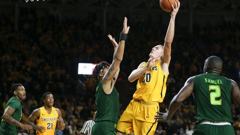 Wichita State center Rauno Nurger shoots over South Florida forward Isaiah Manderson during the first half of an NCAA college basketball game on Sunday, Jan. 7, 2018, in Wichita, Kan. (Travis Heying/The Wichita Eagle via AP)