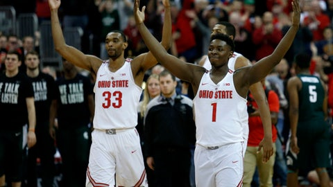 Ohio State forward Keita Bates-Diop, left, and forward Jae'Sean Tate celebrate following their NCAA college basketball game win over Michigan State in Columbus, Ohio, Sunday, Jan. 7, 2018. (AP Photo/Paul Vernon)