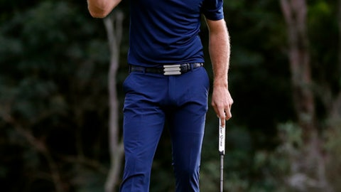 Dustin Johnson pumps his fist after winning the Tournament of Champions golf event, Sunday, Jan. 7, 2018, at Kapalua Plantation Course in Kapalua, Hawaii. Johnson finished 24 under par. (AP Photo/Matt York)