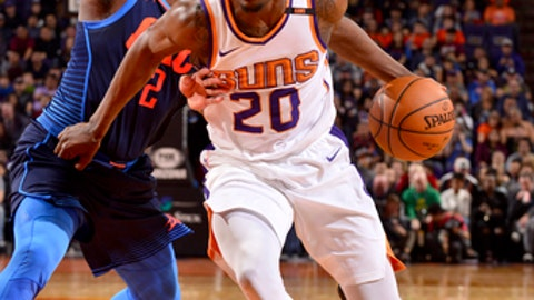 PHOENIX, AZ - JANUARY 7:  Josh Jackson #20 of the Phoenix Suns handles the ball against the Oklahoma City Thunder on January 7, 2018 at Talking Stick Resort Arena in Phoenix, Arizona. NOTE TO USER: User expressly acknowledges and agrees that, by downloading and or using this photograph, user is consenting to the terms and conditions of the Getty Images License Agreement. Mandatory Copyright Notice: Copyright 2018 NBAE (Photo by Barry Gossage/NBAE via Getty Images)