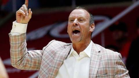 Utah head coach Larry Krystkowiak shouts to his team in the second half during an NCAA college basketball game against Arizona State Sunday, Jan. 7, 2018, in Salt Lake City. (AP Photo/Rick Bowmer)